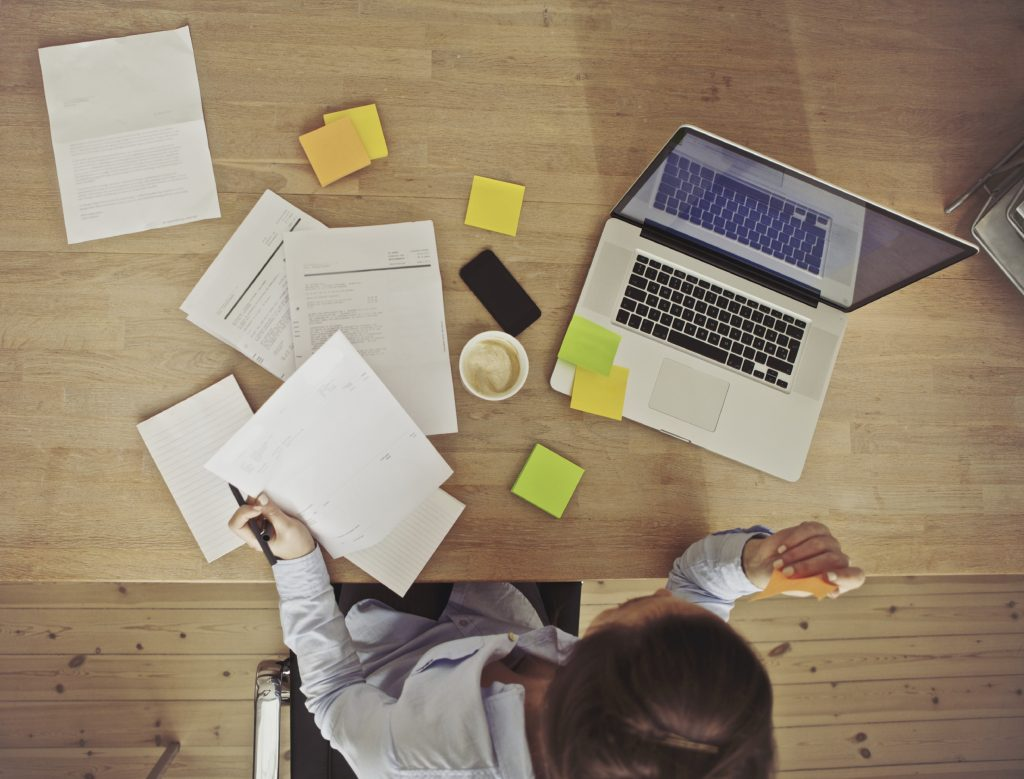 Overhead view of businesswoman working at desk