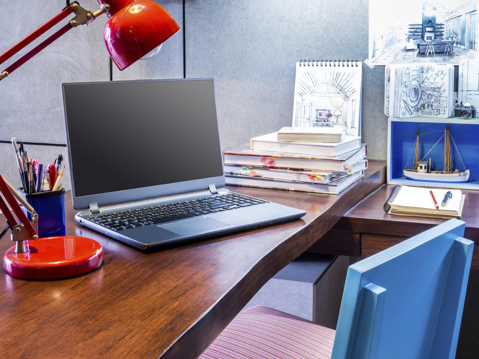 Designer modern home office desk with laptop
