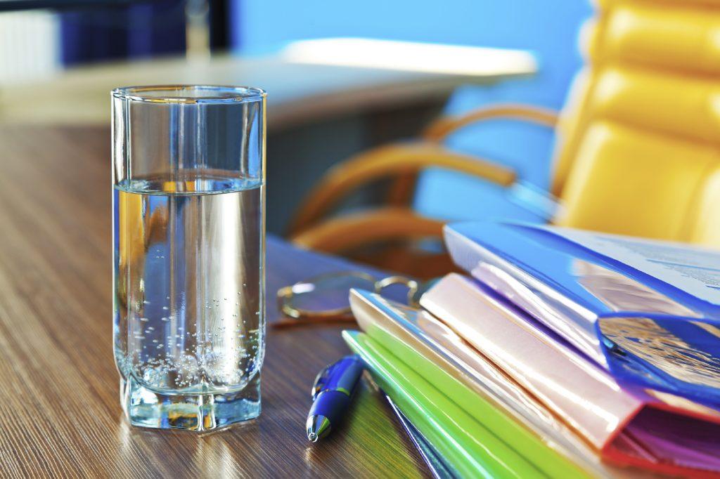 Glass-of-Water-On-Desk-iStock_000016252097_Medium