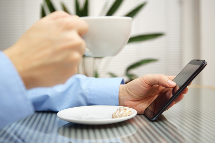 using phone at coffee shop iStock_000036530458_Small