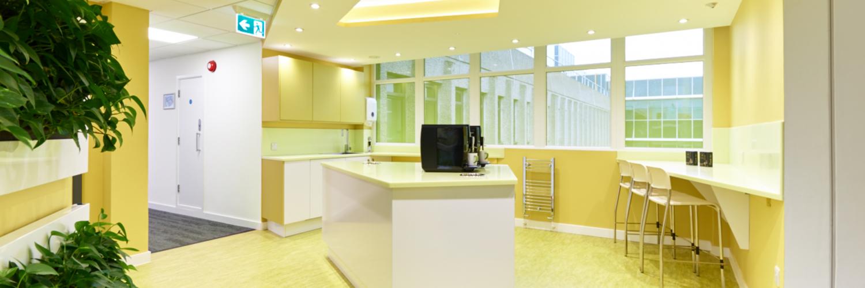 yellow office kitchen and tea point area