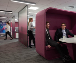 Pink meeting pod with high back and side walls